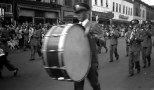 The Mauston High School Marching Band performs in a parade in downtown Portage, Wis., ca. 1948. In the foreground is bass drummer David D. Hanneman (1933-2007) of Mauston.