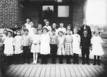 The second photo was taken outdoors at an entrance to the school. Carl is third from the left in the first row. At the time, the Hannemans lived on Baker Street in Grand Rapids, so the Howe School would have been the closest public school. But the building in the photo does not match exterior details of the Howe School, so it's unclear where Carl spent his elementary school years.