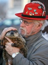 Jerry Hahn pets Jimmy the Groundhog, who has been in his care since 2003.