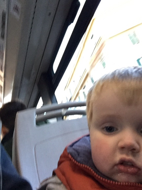 Jaxon rides the bus after exploring Rome