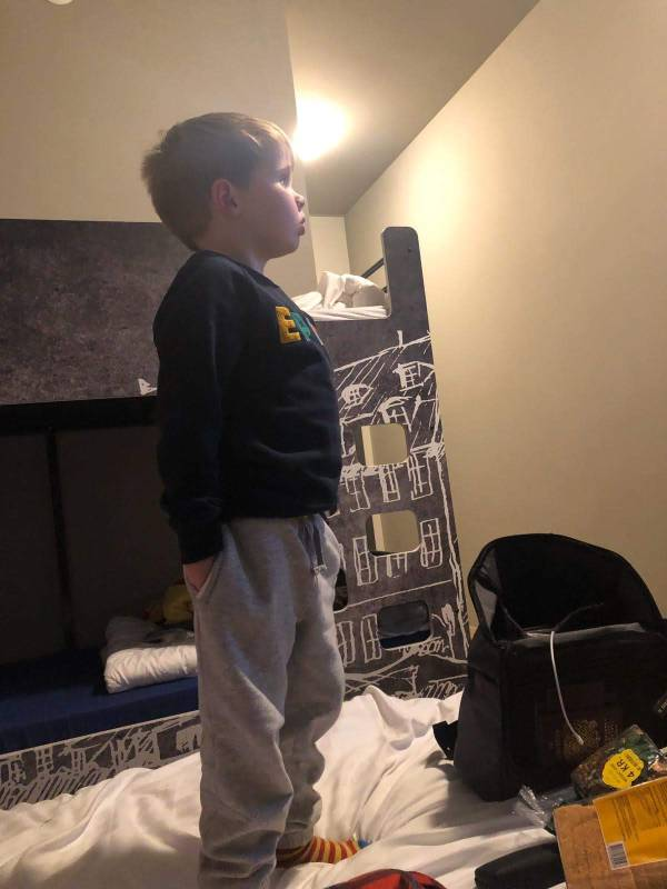 Jaxon stood on the bed watching cartoons