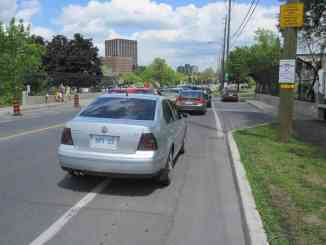 cars on bike lane in Ottawa