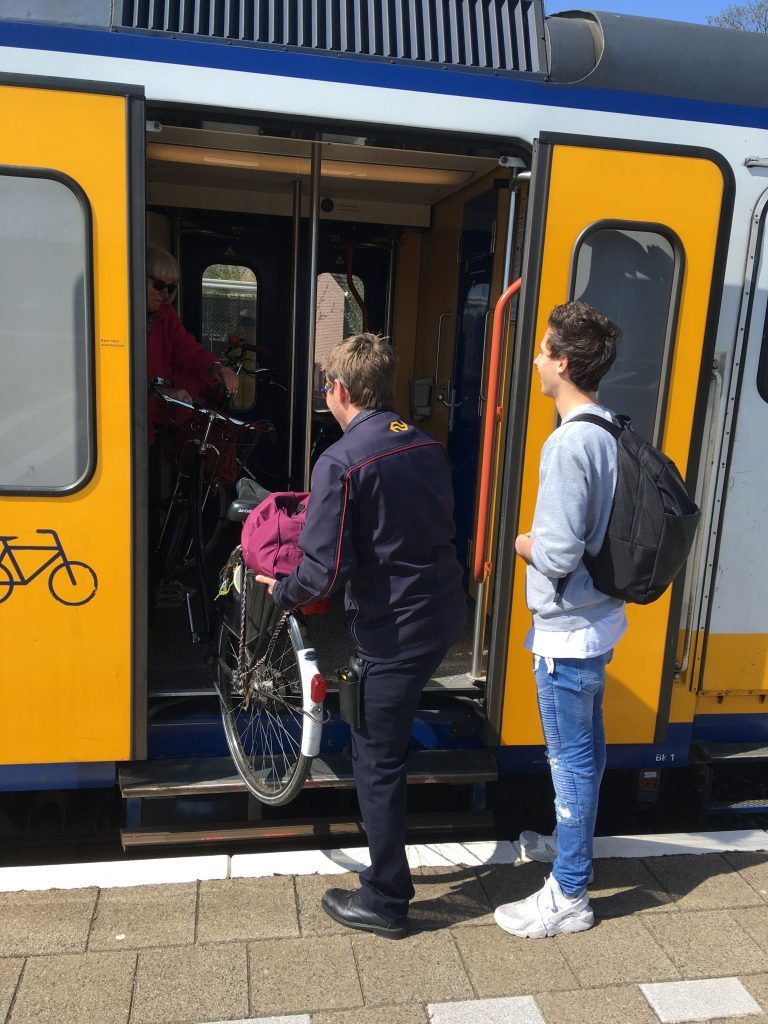 Train conductor who helped a Dutch lady getting her bike of the train