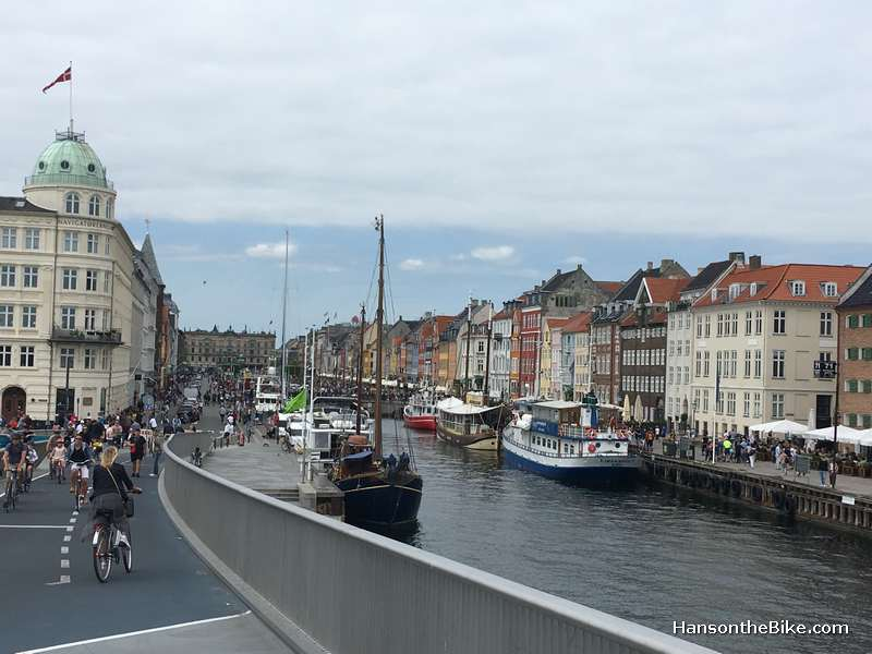 A view from the somewhat awkward designed (with an angle halfway) Inderhavnsbroen towards the place that every one has a photo of: Nyhavn