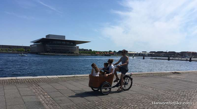Cycling along the water is very pleasant everywhere in Copenhagen. It is all car free and there are no fences. In the background the Opera House.