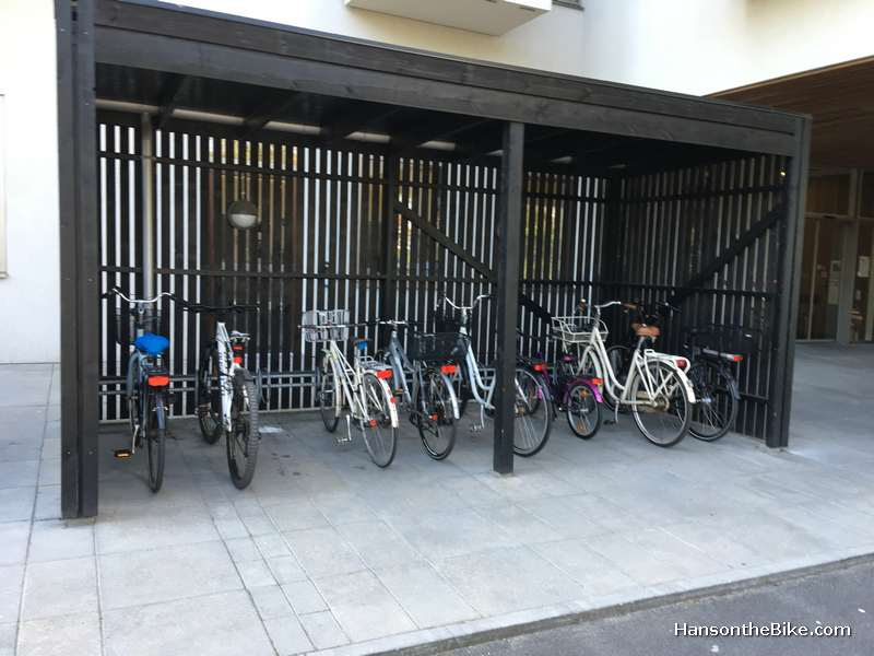 I liked these kind of bike parking. Light design but effective. I saw this at condos and apartments. But again, wheel benders.