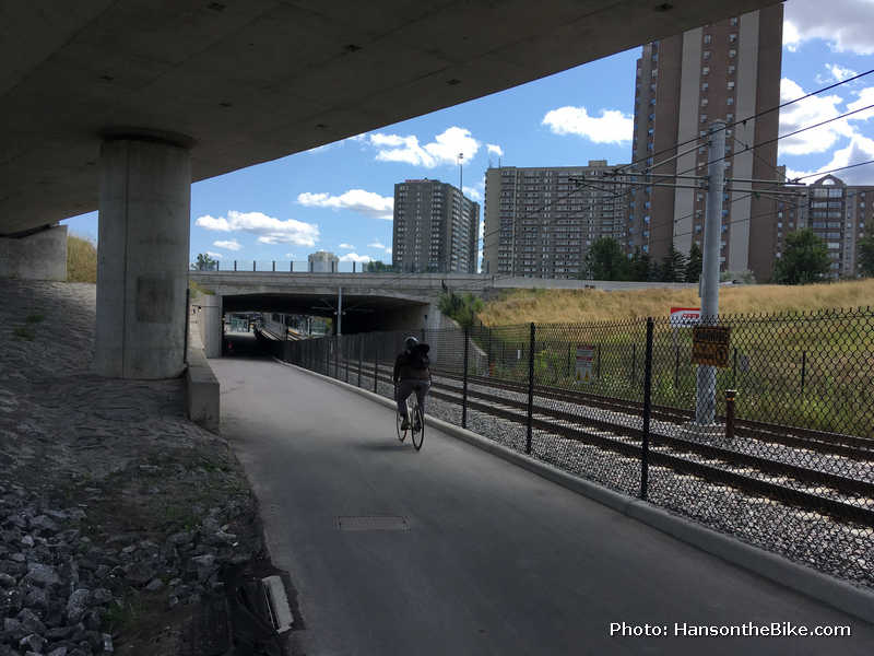 The path cuts through the spaghetti of roads and highways and highway ramps. Here the path goes underneath the 417
