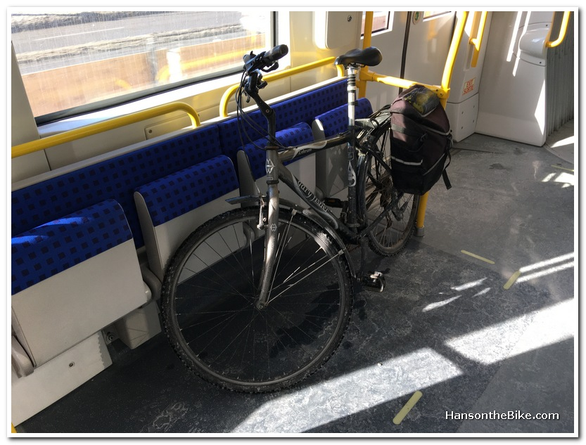 bike in train leaning against chairs