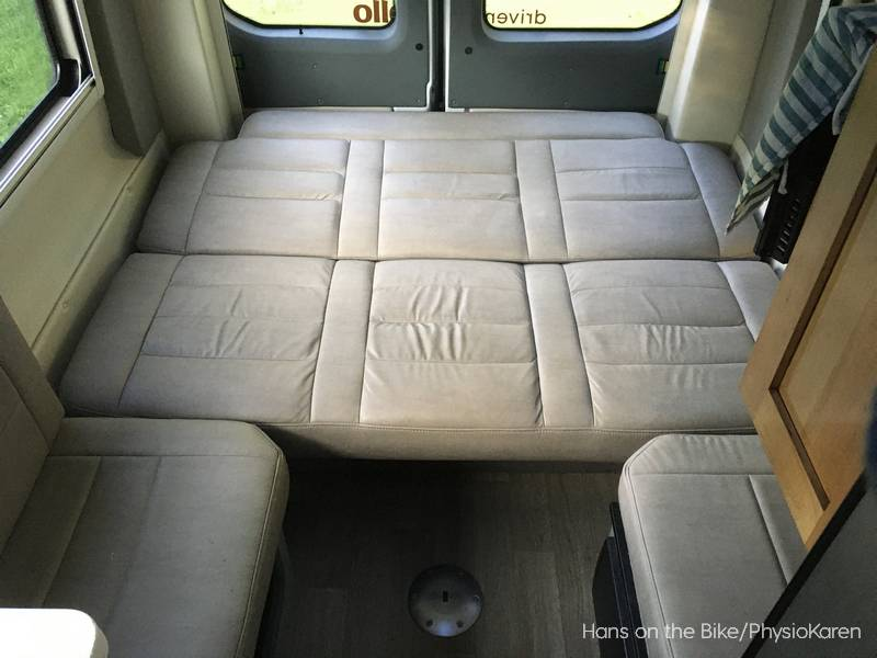 campervan inside with bed folded out