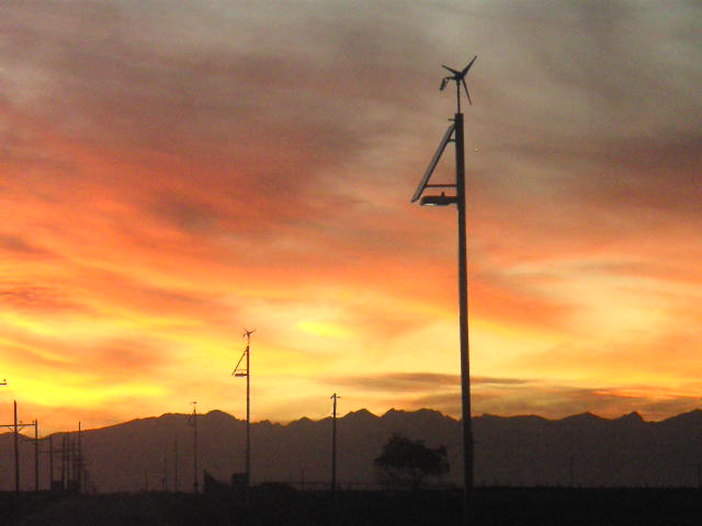 Street lights we manufactured & installed in Colorado with small wind turbines, a PV panel & batteries completely off the grid.