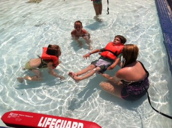 Practicing floating during swim lessons