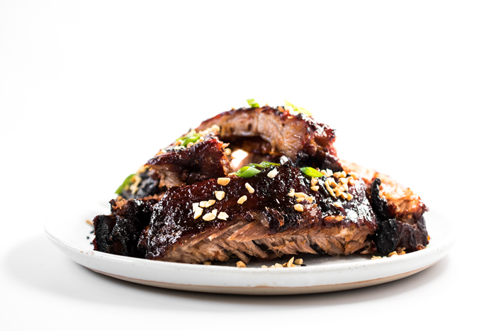Oven baked Spicy Pork Ribs - they're fall off the bone good! And SO easy to make!