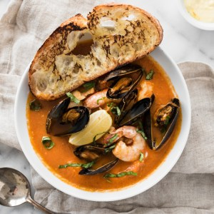 Easy, One Pot Bouillabaisse - Fresh fish, mussels, clams, and shrimp in a rich tomato-based broth