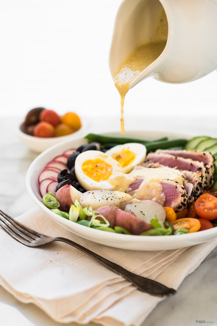 Perfectly seared sesame crusted ahi tuna on a bed of fresh veggies, topped with a creamy egg, and drizzled with a finger-licking good vinaigrette, gives this Nicoise Salad a 'WOW' factor!