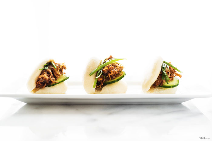Freshly made steamed buns (gua bao) with pulled pork, dressed with a sriracha bbq sauce, topped with a quick pickle cucumber, and scallions. A...ma...zing!