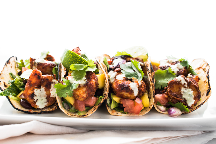 Blackened Shrimp Tacos with Black Bean Mango Salsa and Jalapeño Aioli - spicy, tangy, sweet, and completely delicious! Bring an appetite and lots of napkins!