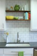 Use shelves to take advantage of the space above the sink [source]