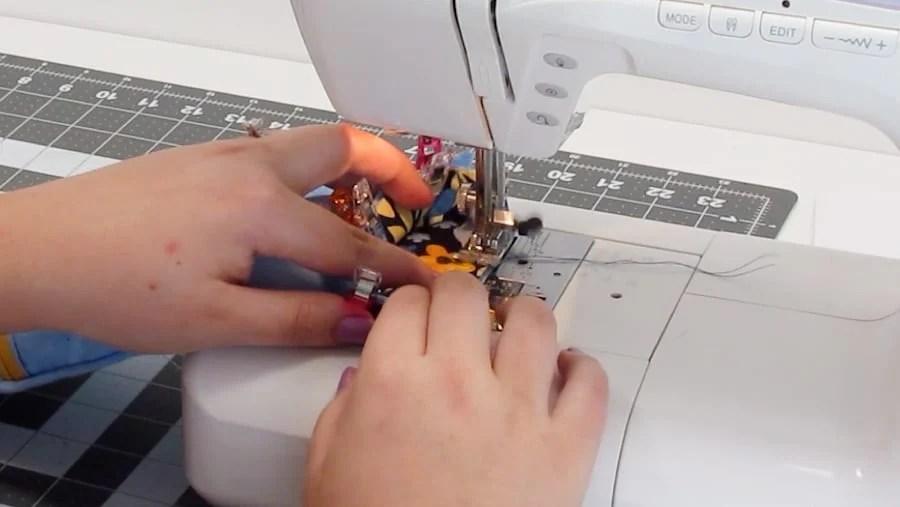 sewing binding around bottom of water bottle holder