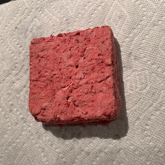 This is what frozen raw dog food looks like.