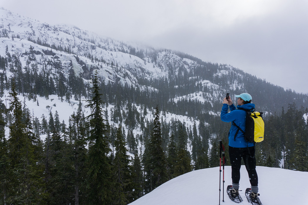 Snowshoeing at the top of the Sea to Sky Gondola in Squamish. Find out how to stay safe in the mountains in the winter with these 8 tips for winter hiking.