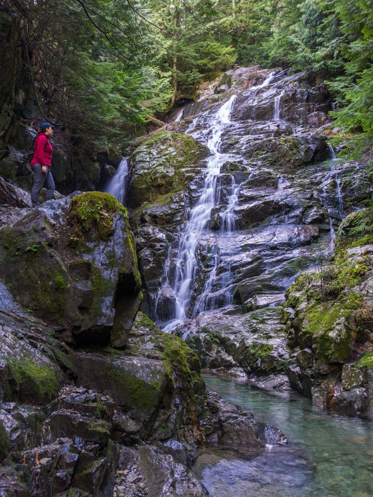 A hiker at Kennedy Falls in North Vancouver, BC