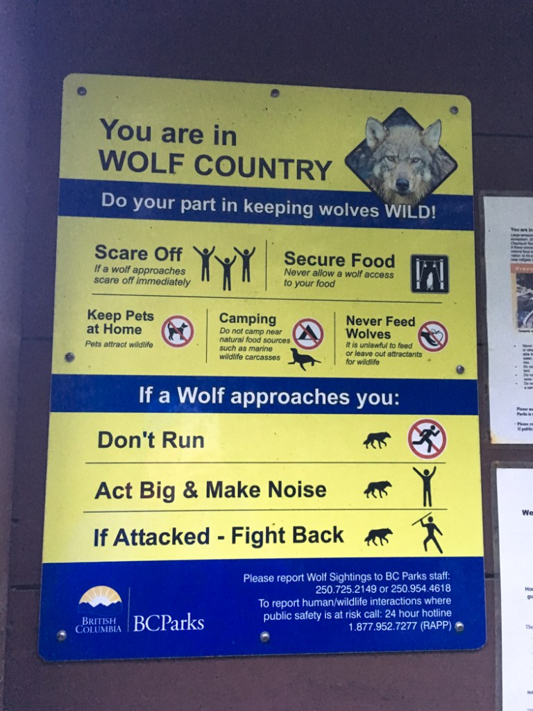 Sign warning about wolves on the Wild Side Trail near Tofino, BC