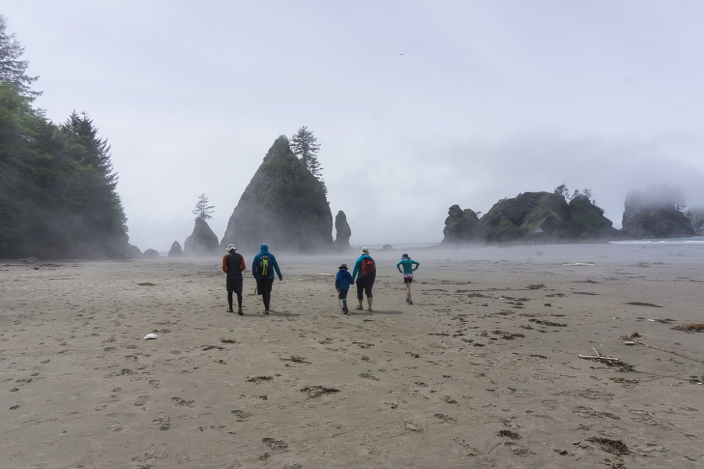 Walking through mist at Point of the Arches at Shi Shi Beach. A complete guide to hiking and camping at Shi Shi Beach.