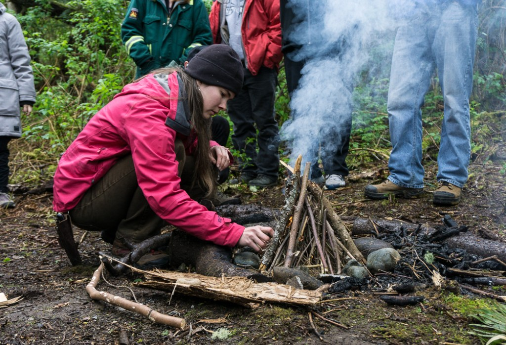 Learning to make fire in a wilderness survival course with Megan Hanacek and Carleigh Fairchild