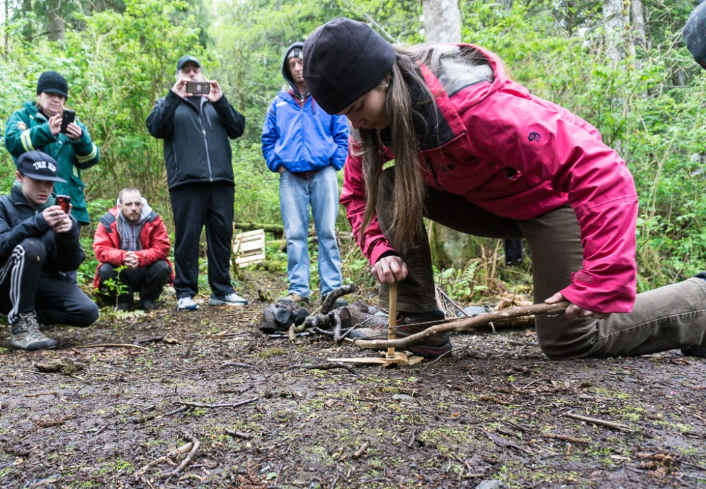 Learning to make a bow drill fire in a wilderness survival course with Megan Hanacek and Carleigh Fairchild