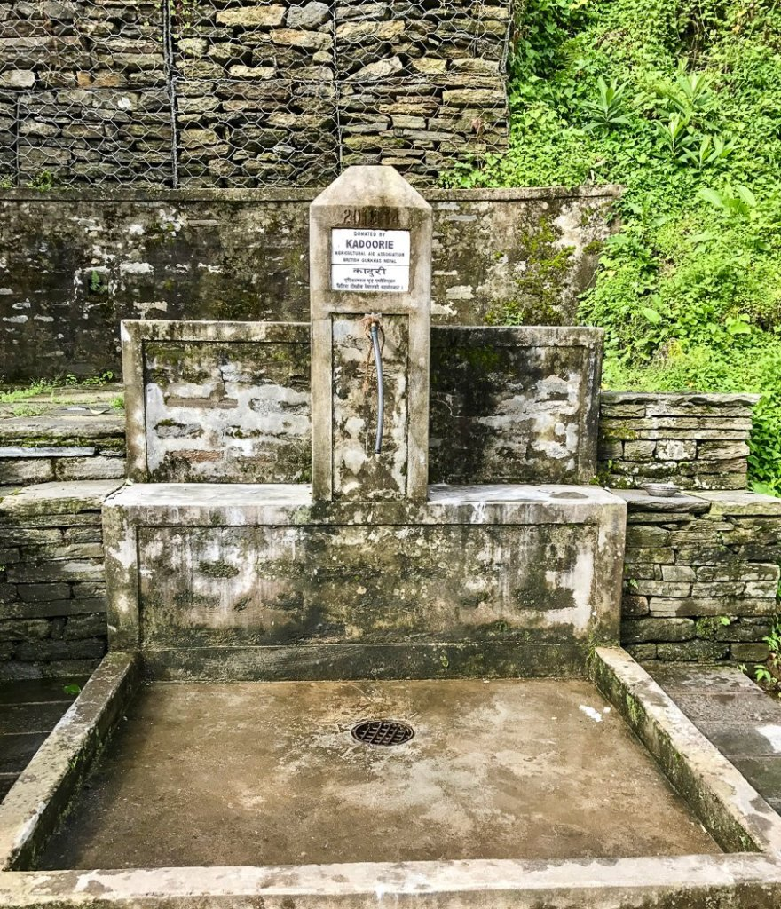 A communal water tap on the Annapurna Sanctuary Trek. 8 things I wish I knew before going trekking in Nepal.