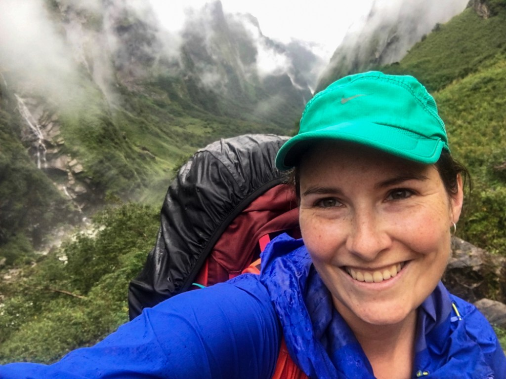 A trekker on the Annapurna Base Camp trek in the monsoon season. What to pack for the Annapurna Base Camp Trek in Nepal.