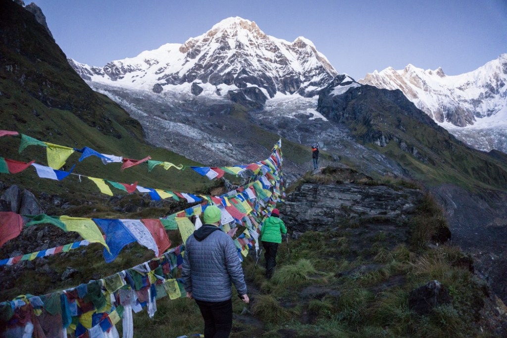 Trekkers viewing the sunrise at Annapurna Base Camp. What to pack for the Annapurna Base Camp Trek in Nepal.