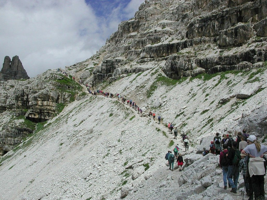 A busy trail in the Italian Alps. Don't like crowds? Here are 15 ways to avoid crowded hiking trails.
