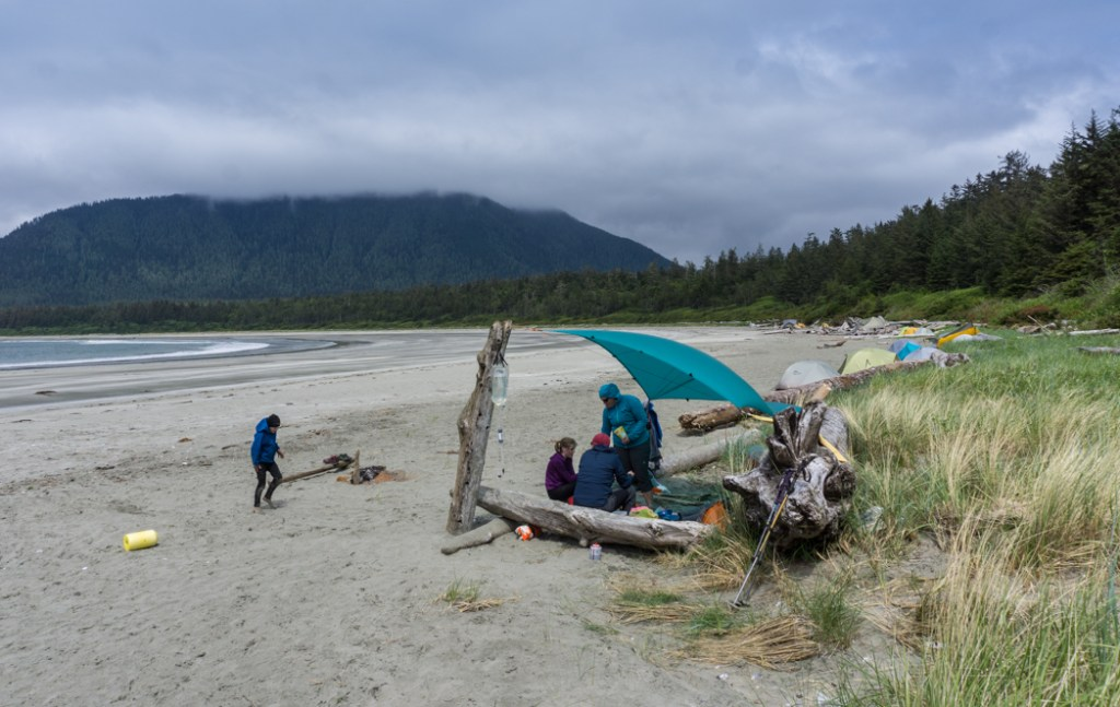 Camp kitchen under a tarp on a beach. How to choose backpacking meals.
