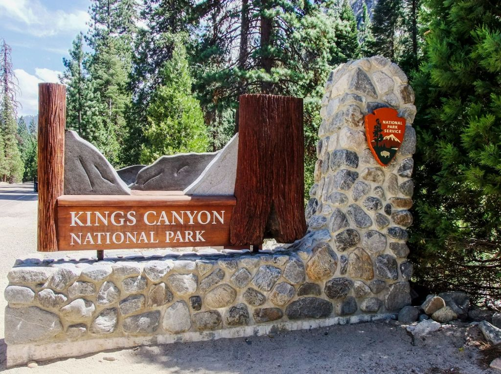 Checking out the entrance sign at Kings Canyon National Park - just one of many things to do in Sequoia and Kings Canyon National Parks.