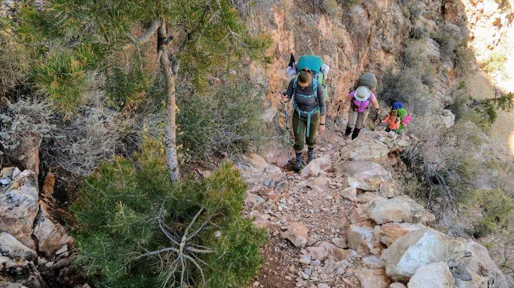 Hiking in the Grand Canyon. Get tips for hiking in the desert including what gear you need, what to wear and how to stay safe.