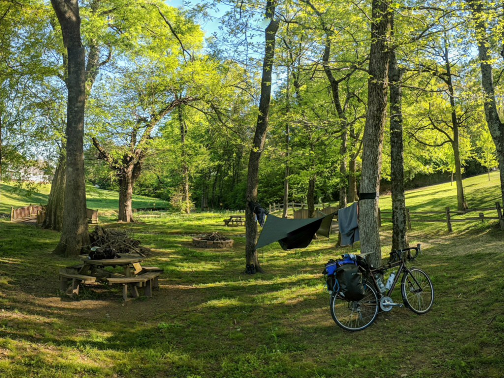 Camping at the town park in Collinwood, TN on a bike tour of the Natchez Trace. Learn how to cycle tour the Natchez Trace Parkway in this detailed guide.