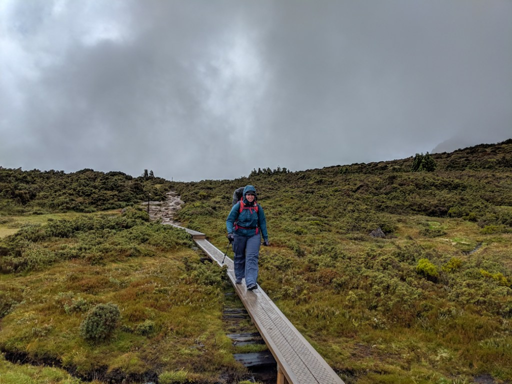 Wearing full rain gear. I recommend keeping your rain jacket and pants handy at all times on the Overland Track