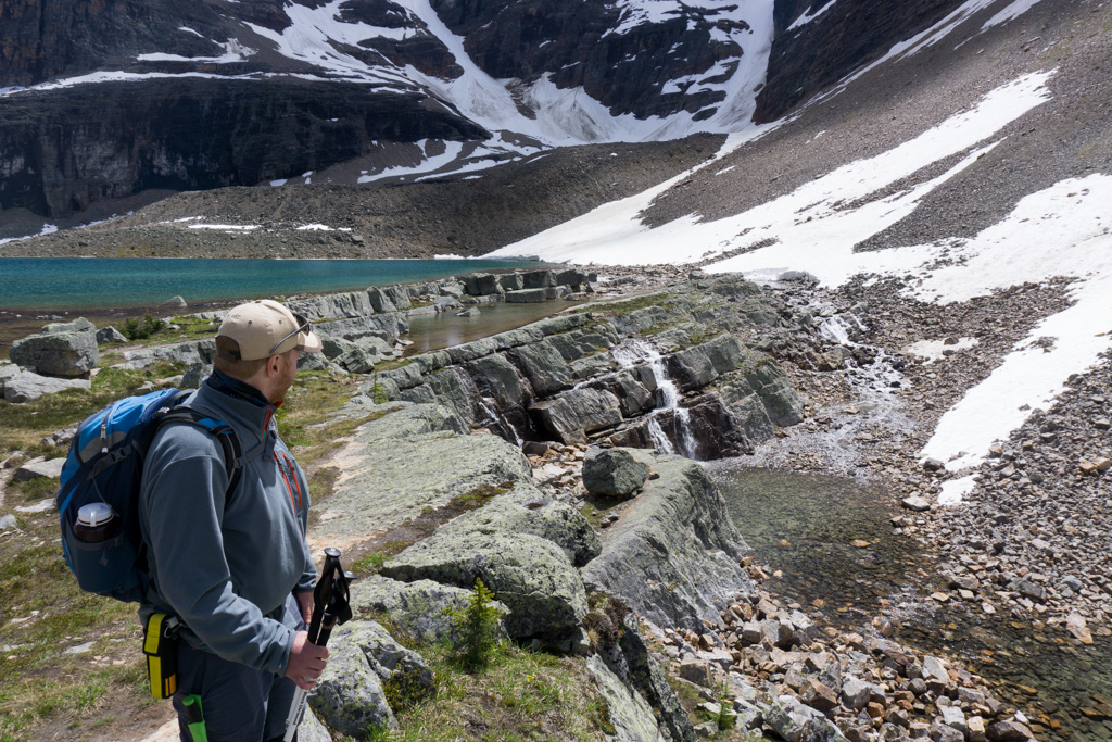 A hiker wearing bear spray in a hip holster near Lake O'Hara. You should pack bear spray for your Lake O'Hara trip.