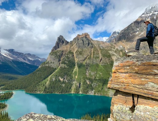 A hiker at Opabin Prospect above Lake O'Hara in Yoho National Park. Find out what to bring to Lake O'Hara with this Lake O'Hara packing list for campers and hikers.