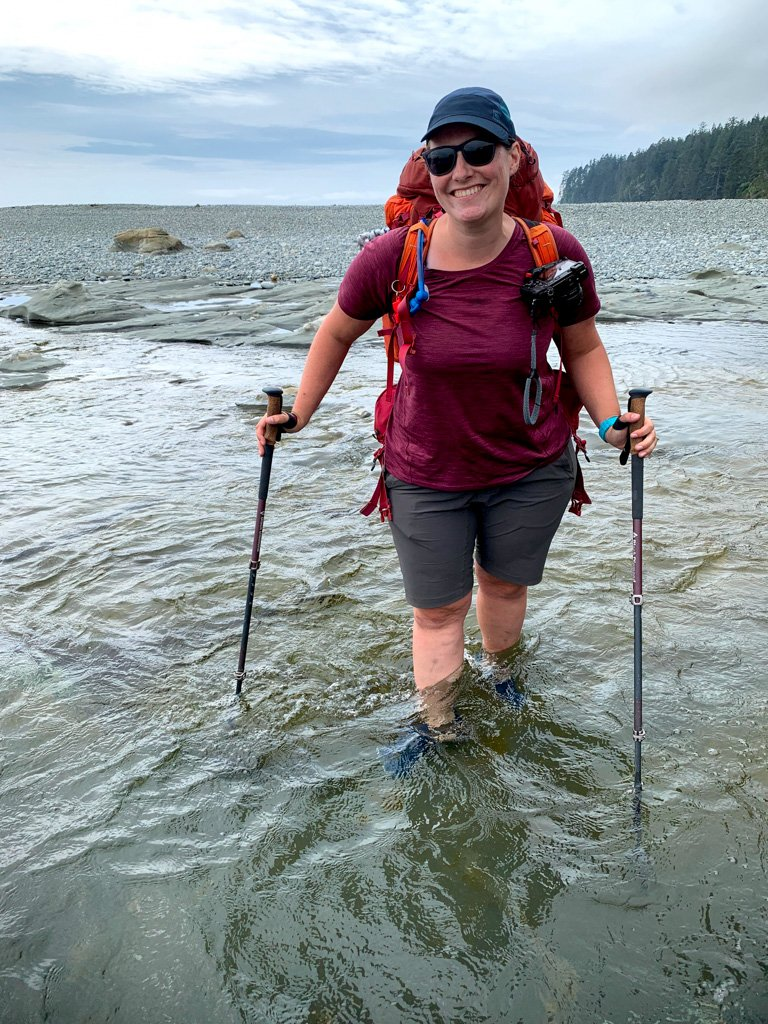 A hiker crossing Walbran Creek on the West Coast Trail