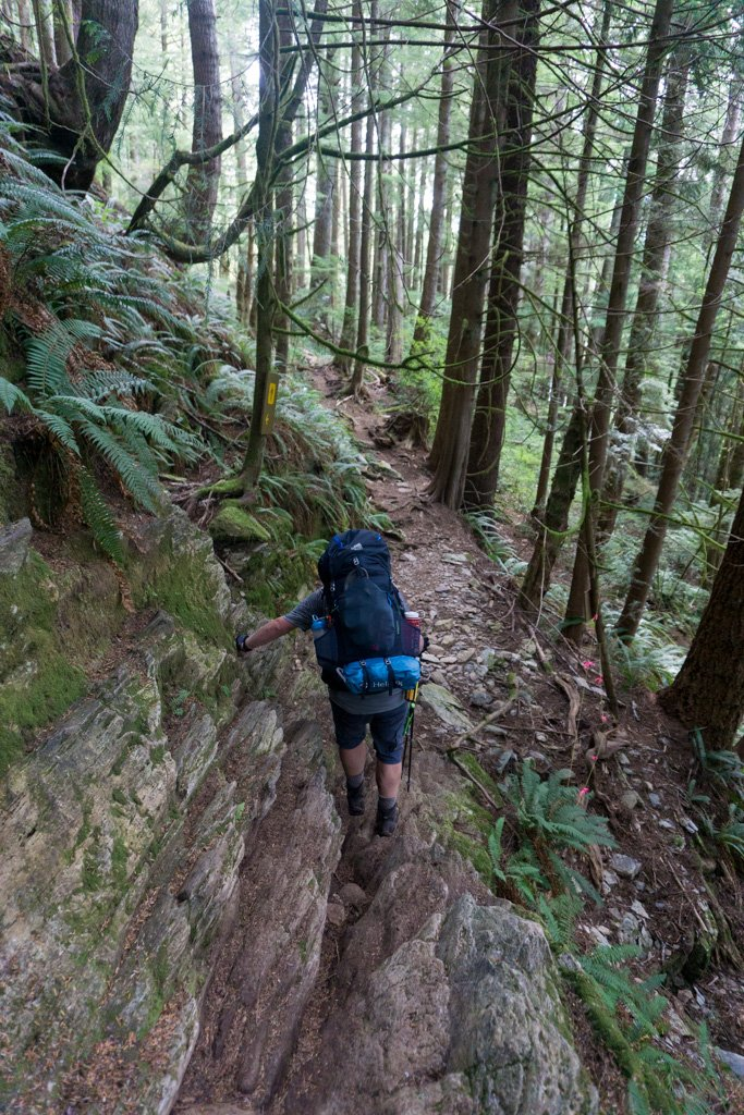 Descending a rocky section near Gordon River on the West Coast Trail