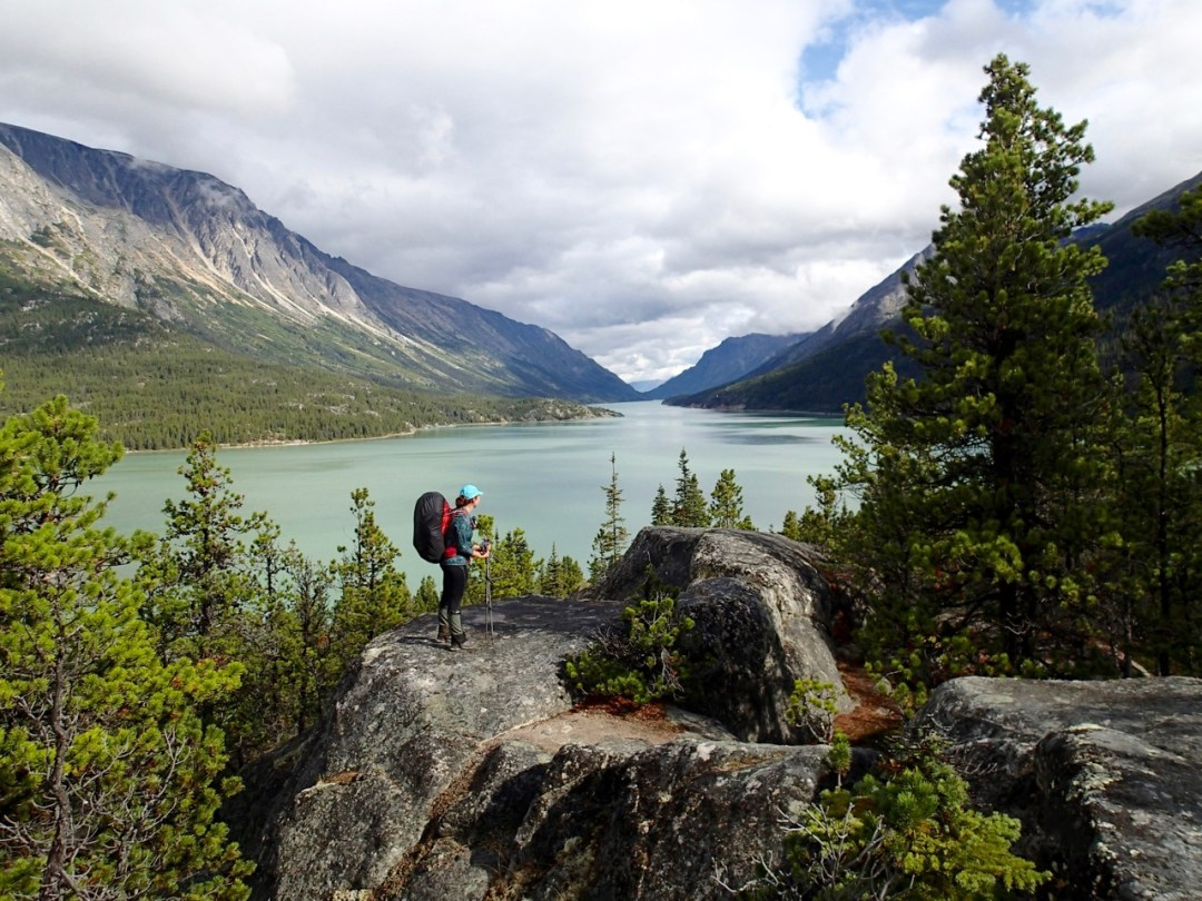 Woman wearing a backpack on the Chilkoot Trail.