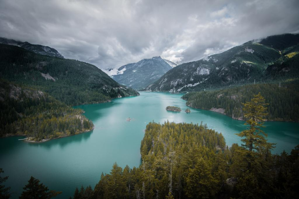 The turquoise waters of Diablo Lake surrounded by mountains in North Cascades National Park in Washington