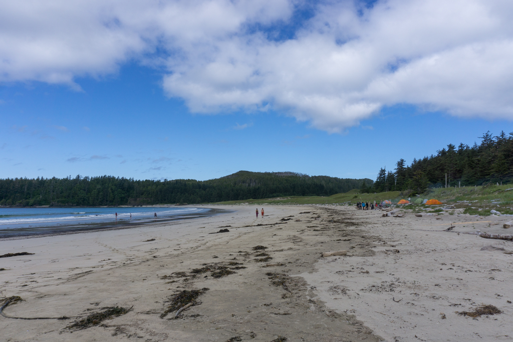 Hikers and campers on the beach at Guise Bay in Cape Scott Provincial Park on North Vancouver Island in British Columbia