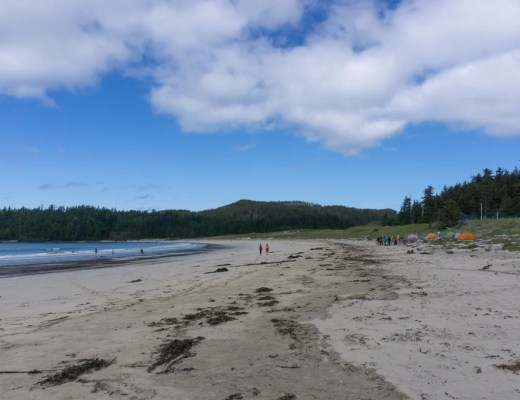 Hikers and campers on the beach at Guise Bay in Cape Scott Provincial Park on Vancouver Island in British Columbia