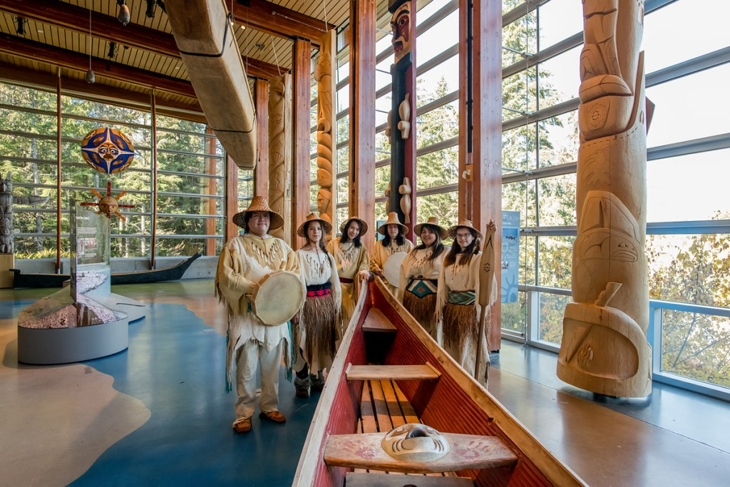 Cedar canoe and indigenous guides at the Squamish Lil'wat Cultural Centre in Whistler