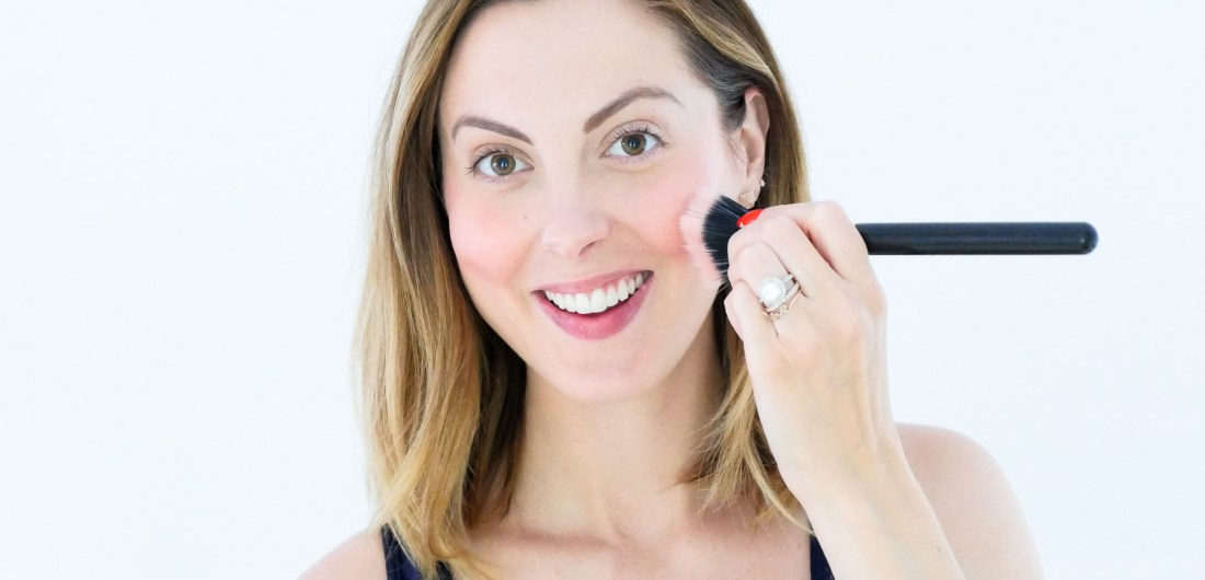 Eva Amurri Martino of Happily Eva After blog applies chantecaille cream blush to her cheeks and blends with a brush as part of her September Beauty Picks