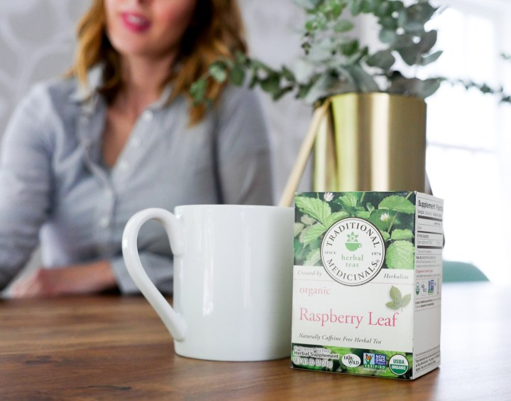 Eva Amurri Martino of lifestyle blog Happily Eva After, shows off her use of traditional medicinals teas during pregnancy in her dining room, featuring raspberry leaf tea