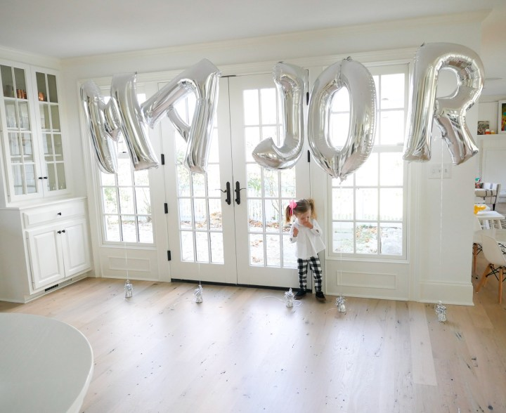 Marlowe Martino playing with balloons spelling out her little brother Major's name at his Sip And See
